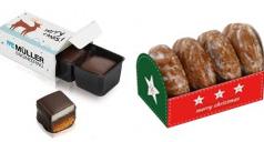 Domino-Steine in einer individuell bedruckten Papp-Verpackung und kleine Oblaten-Lebkuchen im individuell gestalten Werbe-Schuber.