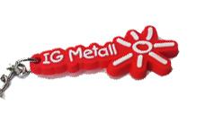 Schlüsselanhänger mit IG Metall-Logo und einer Sonne in Form dieses Logo. Die Basis ist rot, das Logo hebt sich weiß ab.